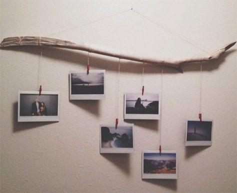 Decorar con fotos colgando de una rama
